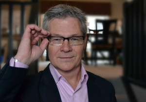 David Cory adjusts his glasses